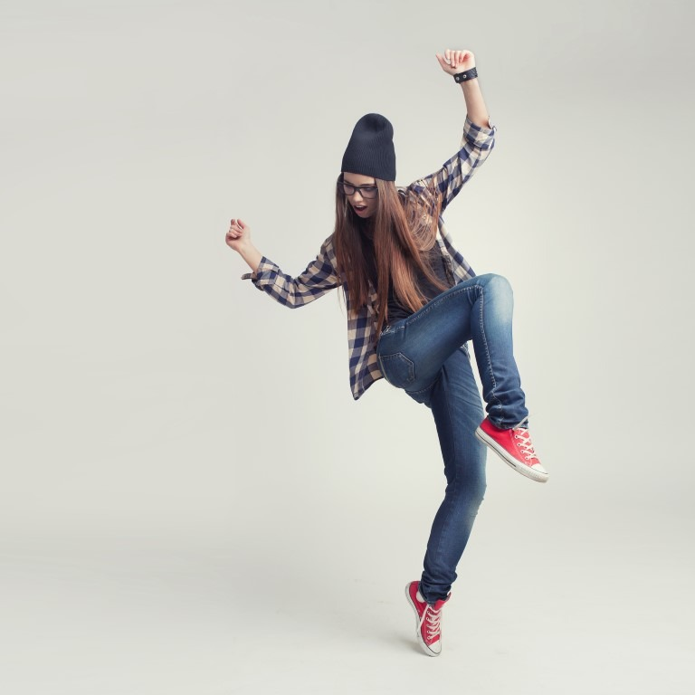da942f590c1 Dancing hipster girl in glasses and black beanie - The Exhibit Company